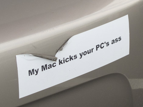 "bumper sticker reading ""My Mac kicks your PC's ass"""